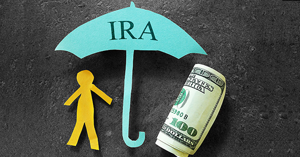 person under ira umbrella with money