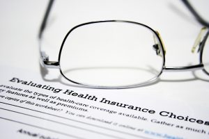 Close up of glasses on health insurance