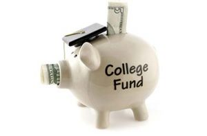 piggy bank with graduation cap and money sticking out