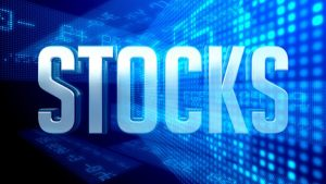 stocks in front of digital screen